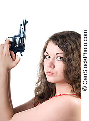 Young woman with a pistol. Isolated on white