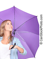 Young woman with a purple umbrella