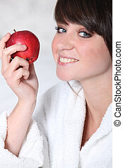 Young woman with a red apple