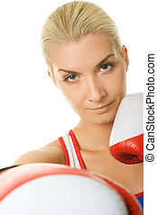 Young woman with a red boxing gloves