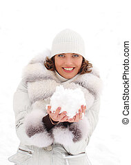 Young woman with a snowball over the white background