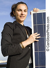 Young woman with  a solar panel