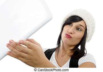 young woman with a tablet makes a selfie, on white