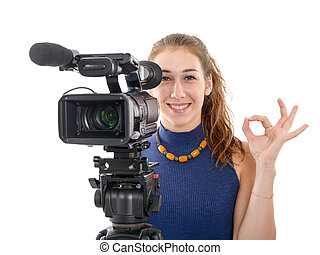 young woman with a video camera, ready for filming on white background