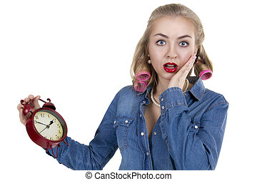 Young woman with alarm clock - Frightened young woman in...