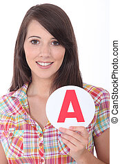 Young woman with an A sign