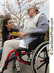 Young woman with an elderly lady in a wheelchair