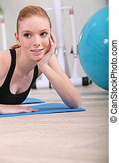 Young woman with an exercise ball