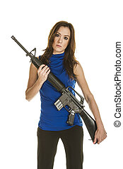Young woman with assault rifle - A young woman in blue...