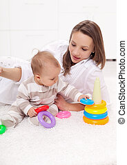 Young woman with baby girl playing