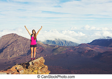 Young Woman with Backpack on Mountain Peak with Open Arms