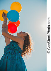 young woman with ballons. lensbaby picture