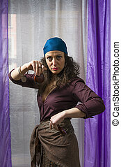 young woman with bandana shaking castanets