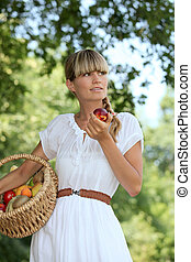 Young woman with basket of fruit