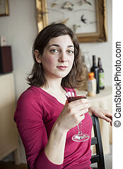 Young Woman with Beautiful Green Eyes Drinking Wine