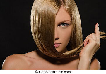 young woman with beautiful straight hair on black background
