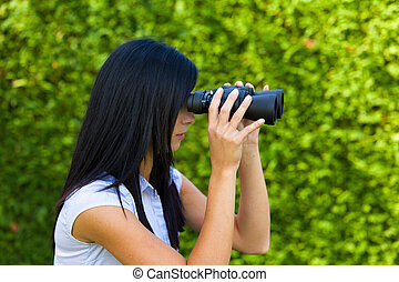 Woman with binoculars looking for the future