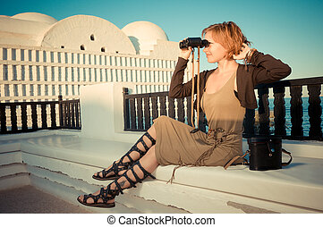 Young woman with binoculars