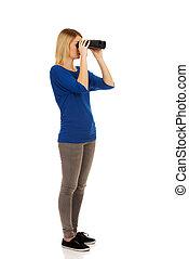 Young woman with binoculars.