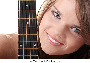 Young woman with black clasic guitar