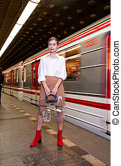Young woman with blonde hair in the metro
