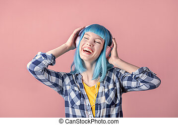 Young woman with blue hear listen to music