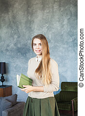 Young Woman with Book at Home