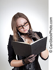 Young woman with book  - Young woman with book, studio shot