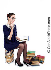 Young woman with books pile isolated on white