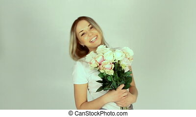 Young woman with bouquet of many roses