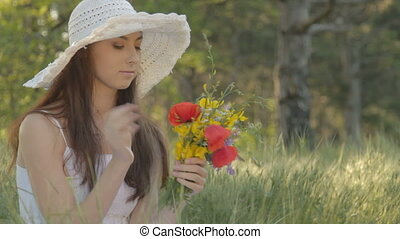 Young woman with bouquet resting on