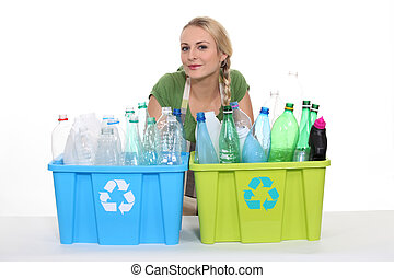Young woman with boxes for plastic recycling