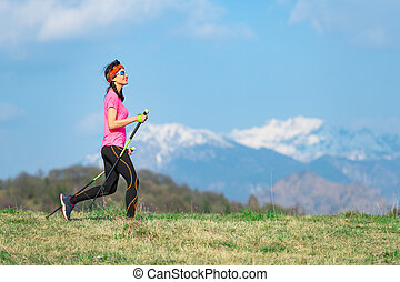 Young woman with braids in her hair during a sport walk in the mountains