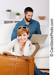 Young Woman With Briefcase And Man Using Laptop