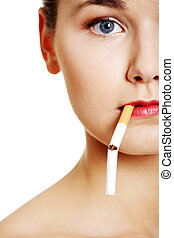 Young woman with broken cigarette.