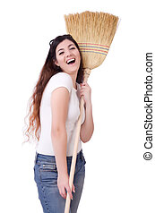 Young woman with broom on white