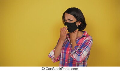 Young woman with brown hair wear black pollution mask. ...