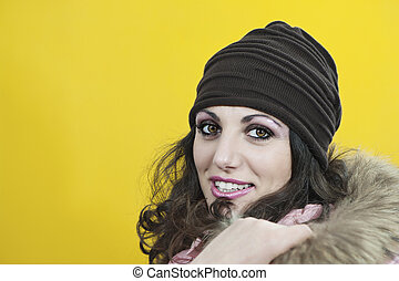 young woman with brown hat and yellow background