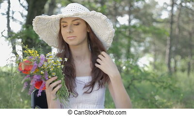 Young woman with bunch rest on natu