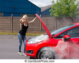 young woman with car on fire