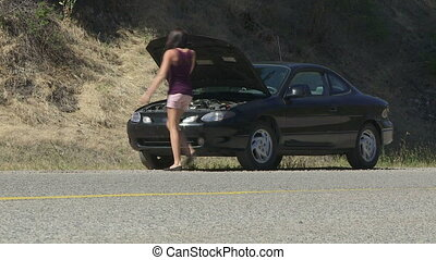 Young woman with car troubles