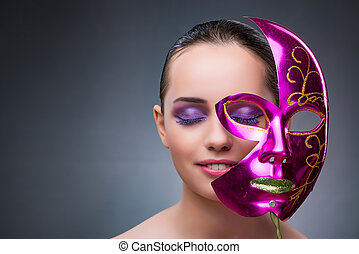 Young woman with carnival mask
