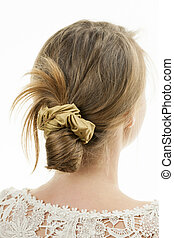 Young woman with casual messy bun hairdo - Studio shot of...