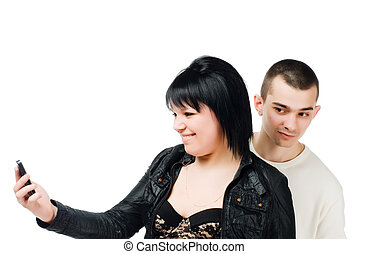 Young woman with cell phone and guy eavesdropping
