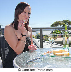 young woman with cheese and wine