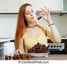 young woman with cherries