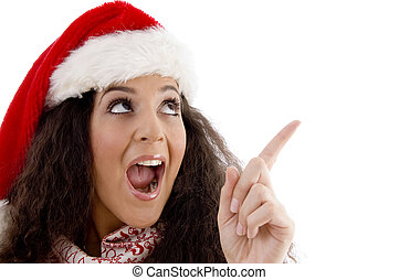 young woman with christmas hat indicating upward