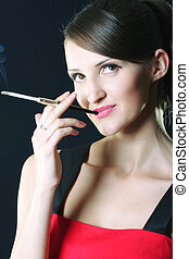 Young woman with cigarette looking up