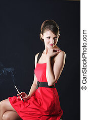 Young woman with cigarette on chair