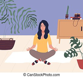 Young woman with closed eyes sitting cross legged on floor ...